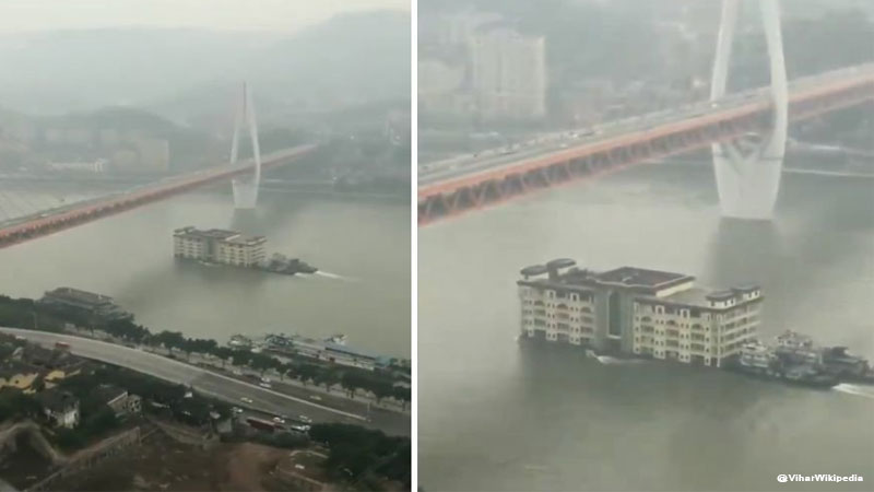 building floating across China river