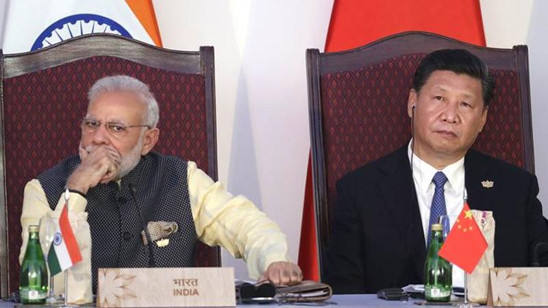 china slams india over new fdi rules calls violation of wto principles