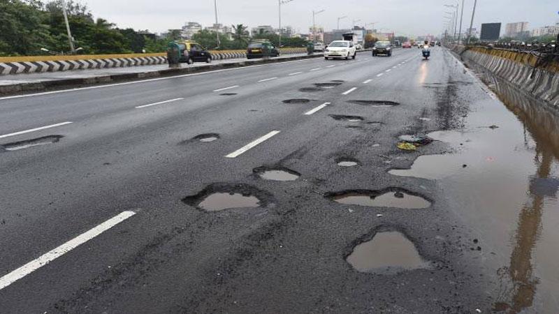 Gujarat AMC rs 450 crore scandal on road repairing resurfacing