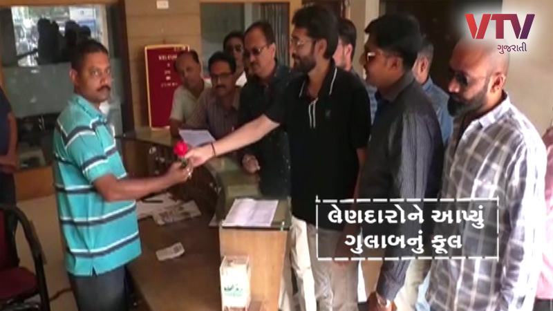 bhuj municipality give rose and notice about taxpayer citizen