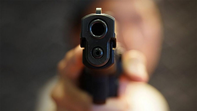Gujarat surat bootlegger gang war firing one Innocent dead