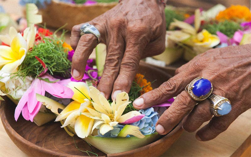 what to do with the flower you get from temples with the prasada