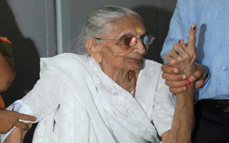 Heeraben Modi, Prime Minister Narendra Modi's mother casts her vote at a polling station in Raisan, Ahmedabad