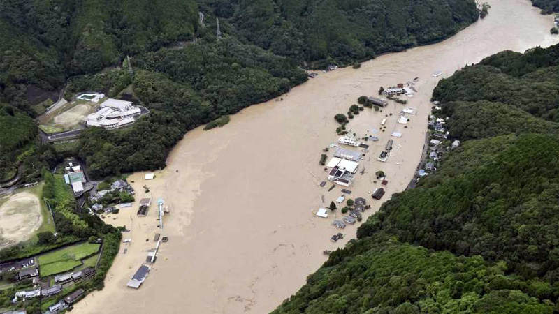 Japan flooding fourteen dead in flooded care home