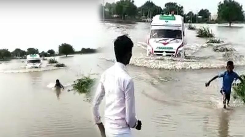 12 Year Old Boy Venkatesh Guides Ambulance Over Flooded Bridge karnataka