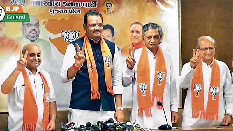 Gujarat bjp minister Kunvarji Bavaliya short out land dispute cases