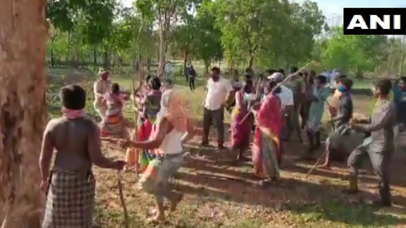 police administration officials beat up by villagers tried to cremate covid 19 positive body in odisha