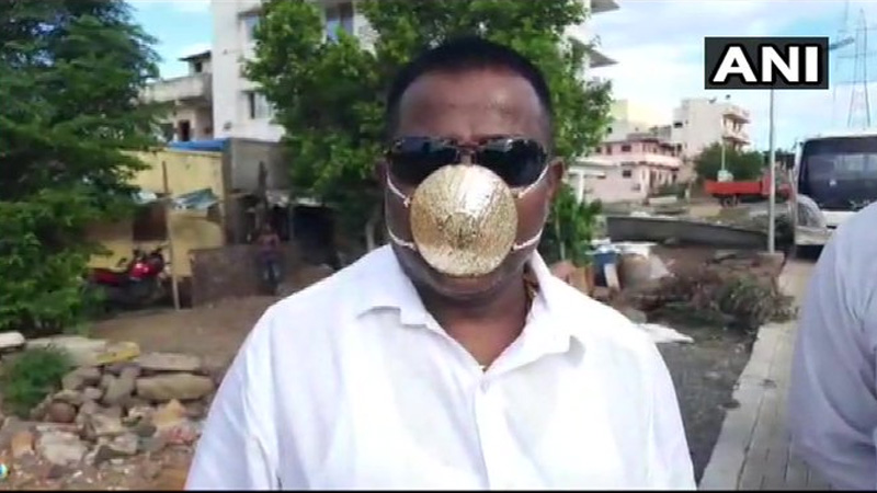 maharashtra shankar of pune got himself mask made of gold worth rs 2.89 lakhs with minute holes