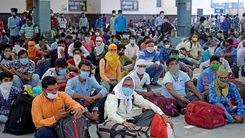 gujarat lockdown migrant worker double salary advance