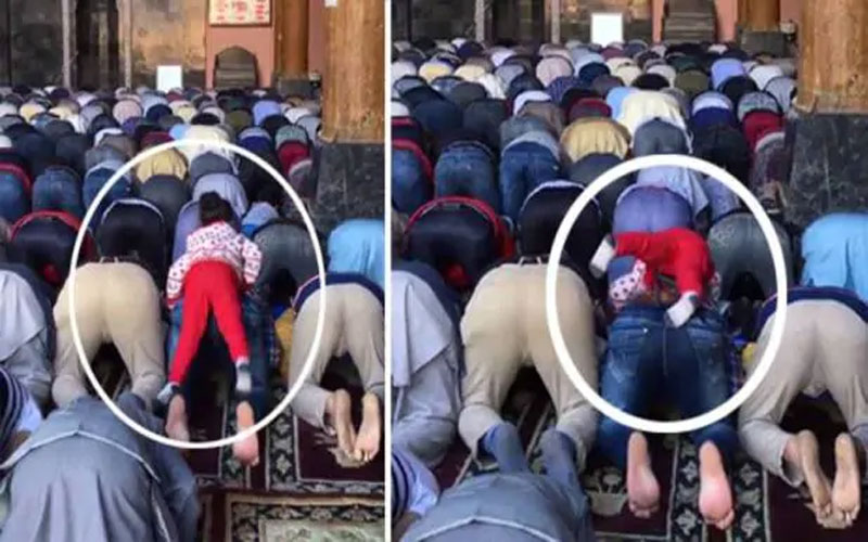 cute-girl-climbing-back-of-father-while-he-offers-prayer-at-jamia-masjid