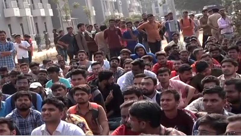 bin sachivalay exam scam 4000 candidate stay 2 days Gandhinagar for justice