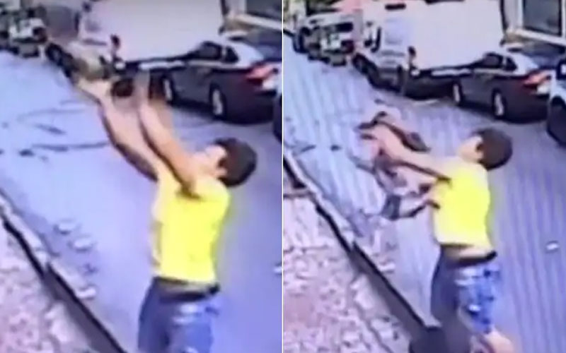 teenage boy catches baby falling from building in a viral video