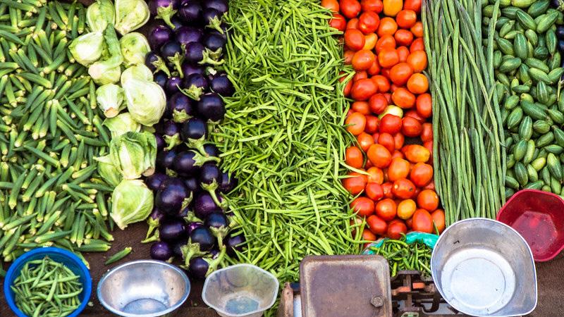 vegetable price down women happy