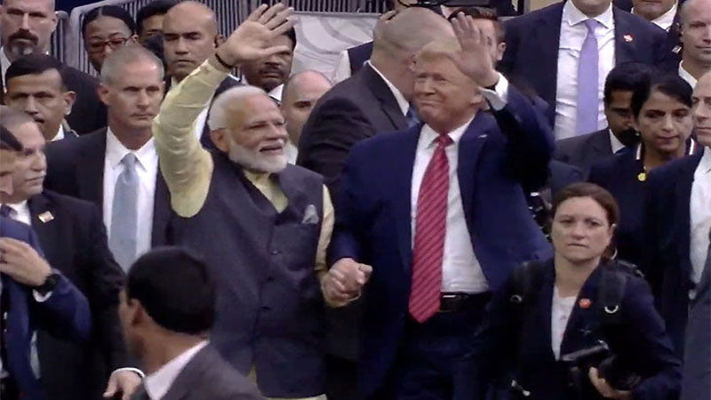 PM Modi and President Trump take a lap around the NRG stadium