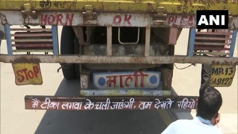 Catchy slogans on vehicles urge people to get vaccinated